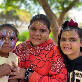 local girls with facepaint at Ashmont Re-Opening Event